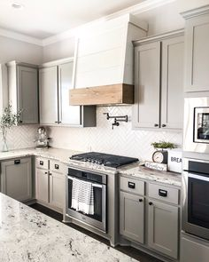 One of our FAVE DIY's ever is the faux oven hood we created simply by taking the cabinet doors off and creating a shell type hood/cover… Diy Kitchen Remodel, Kitchen Redo, New Kitchen, Kitchen Remodeling, Kitchen Ideas, Kitchen Floor, Country Kitchen, Remodeling Ideas, Diy Cabinet Doors