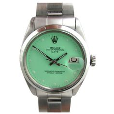 ROLEX Stainless Steel Oyster Date with Custom Mint Green Dial | From a unique collection of vintage wrist watches at http://www.1stdibs.com/jewelry/watches/wrist-watches/