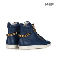 Blue pieced deer leather sneaker. A rock attitude to your casual style to wear with trendy outfits.