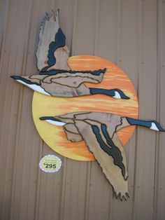 Wood Intarsia Flying Geese pair (6 ft x 5 ft). The geese are offset from the back board with pegs to give it a 3-dimensional effect. Perfect for rustic cabin, lake house or lodge decor handmade by Glass Moose.