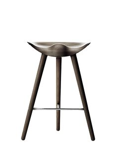 In 1942 Mogens Lassen designed the Stool ML42 as a piece for a furniture exhibition held at the Danish Museum of Decorative Art. He took inspiration from the stools used by the shoemakers of the past, and transferred the light, elegant look to the creation of this sculptural three-legged stool. The Stool ML42 is still manufactured in Denmark to this day with a focus on quality and Danish craftsmanship, and is considered a collector's item by international design connoisseurs.