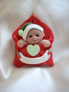 Baby's first Christmas Ornament  Personalized Baby Gift  Polymer Clay Baby Shower Gift. $12.50, via Etsy.