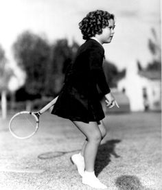 Shirley Temple playing badminton, 1930s.
