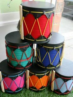 Kwanzaa: African Drum Craft for KidsAfrican drum craft for kids. Perfect for a Kwanzaa unit or Festival of Light.African drum craft to show ancient history.your weekly dose of crafty inspiration: July 2008 Drums For Kids, Music For Kids, Diy For Kids, Crafts For Kids, Music Crafts, Vbs Crafts, Diy Kwanzaa Decorations, Instrument Craft, Musical Instruments