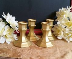 A personal favorite from my Etsy shop https://www.etsy.com/listing/513312149/set-of-4-gold-candle-holders-gold-candle