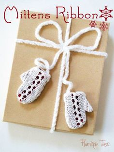 Mittens Ribbon Gift Wrap - Cut out scraps from an old sweater to add dimension to your mittens. This is a great alternative to gift wrap. #tutorial