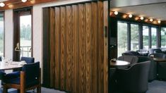 One of the most interesting principle behind accordion doors is that they are seldom made use of as actual entryways as well as exits. Most of the time, these folding barriers are made . Read Best Accordion Doors Ideas for Your House Accordian Door, Accordion Folding Doors, Temporary Wall, Executive Office, Side Wall, Door Curtains, Sound Proofing, Wall Pockets, Blinds