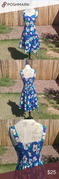 "Simply Hawaiian floral midi tea dress Very good condition. Floral, blue midi dress. Size: L Materials: 100% cotton Measures: Bust- 18"" waist - 15.5"" length- 37.5"" Dresses Midi"