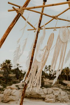 These hand made dream catchers and classic feathers teathered to this angled, drift wood structure looked absolutely haunting flowing in the wind. The perfect addition to a perfect beach location. San Jose Del Cabo, Cabo San Lucas, Wedding Event Planner, Destination Wedding, All Inclusive Resorts, Event Design, Wedding Inspiration, Wedding Ideas, Getting Married