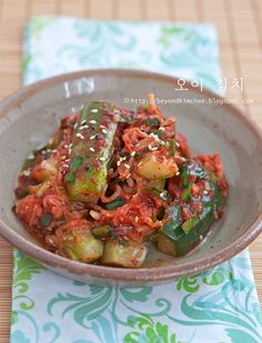 Learn how to make crunch and refreshing Korean cucumber kimchi with step by step instructions.