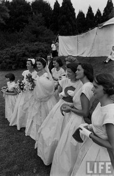 Jackie Bouvier Kennedy and her  bridesmaids posing on the lawn on her wedding day.