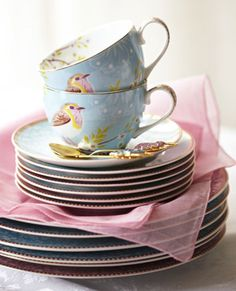 ... cup and saucer afternoon tea pile of saucers with bird printed cups