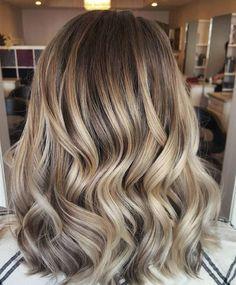 Na Rose Gold hair en Unicorn hair is er nu alweer een nieuwe haartrend: Color Melting!