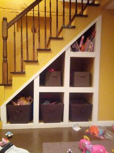 Under the stairs storage! This would be awesome for our new home.