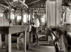 """January 1909. """"One of several youngsters I found in Tampa Cigar Box Factory. They are reported to have many children when work is rushing. About 10 young boys and girls, 300 employees."""" Photo by Lewis Wickes Hine."""