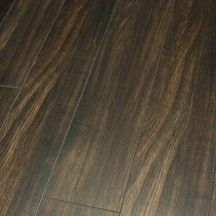Dark Oak Natural Tones run right through this laminate from the Balento Evolution Range (12mm) Burnt Oak V Groove Laminate Flooring.
