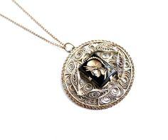 Vintage Roman Warrior Cameo Necklace -  Reverse Carved Warrior Costume Jewelry / Golden Intaglio. $25.00, via Etsy.