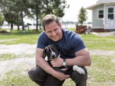 Jason takes a break from smashing things to spend some quality time with adorable furry guest Charlie at the 2014 Blog Cabin in Winter Haven, Florida.
