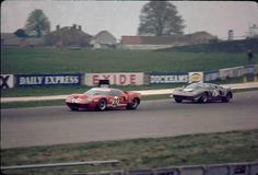 Paul Hawkins in the #32 ex Alan Mann Racing lightweight GT40 chassis AMR/2 leads David Prophet in the #31 GT40 chassis 1002 during the sports car race at the 1968 BRDC International Trophy race meeting at Silverstone. Hawkins finished 3rd, Prophet DNFed.