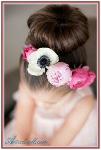 Sock bun or Hot bun for little girls hair or a flower girl hairstyle for 2015 using large flowers such as peonies