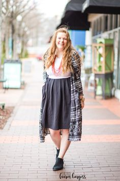 A colorblocked black and white Amelia dress by LuLaRoe is a classic style to take to everyday. Add a punch of interest with a fun print, like this black and white LuLaRoe Sarah duster Cardigan and a bold necklace! Click for more // facebook: LuLaRoe Lauren Burgess Bold Necklace, Lularoe Amelia Dress, Black And White Prints, Lauren, Clothing Items, Color Pop, Classic Style, Punch, Midi Skirt