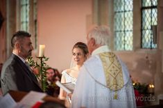 Bride gives groom the look of love during church ceremony at Lulworth Dorset #brideandgroom #dorsetwedding #lulworthwedding