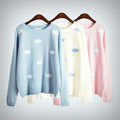 Long-sleeved pullover sweater with white/blue (depending on colour) embroidered rainclouds all over: available in pale blue, pale pink and cream. Measurements: Length - 62cm Shoulders + Sleeves - 69cm Chest - 114cm