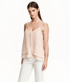 Check this out! Camisole top in chiffon crêpe with narrow shoulder straps and a racer back. Double-layer front section with slit at front. Slightly longer at back. - Visit hm.com to see more.