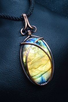 A more simple wire wrap to expose the full flash on this oval labradorite cabochon. Antiqued copper to give a rustic look. Copper Necklace, Copper Jewelry, Pendant Necklace, Handmade Jewellery, Handmade Accessories, Handmade Gifts, Wire Wrapped Pendant, Wire Wrapped Jewelry, Moonstone Pendant