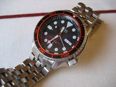 http://forums.watchuseek.com/f21/show-off-your-skx007-009s-262404-387.html