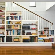 bookshelves on angled stair wall | Interesting use of built in shelves in front of stairs.