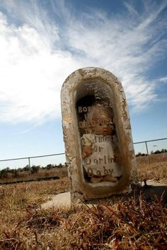 """Fairview Cemetery near Greensburg, Kansas. The sexton had to replace the glass after the Greensburg tornado. Local Legend has it that when the glass broke the doll WALKED OUT, wandered aimlessly for miles, BOUGHT SOUVENIRS AT BETO JUNCTION, and returned just in time for the grave repair.  If you go to this grave at midnight on a full moon and say """"Baby Doll"""" 3 times you will either be given a BETO junction souvenir, or eaten by Wild Prairie Children. BEWARE!!"""