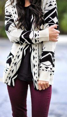 Lovely black triangle design cardigan black shirt and purple leggings for fall.
