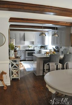 We love the warmth the rug and beams add to our gray and white kitchen. And fun…