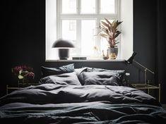 Dit appartement laat zien dat een zwarte slaapkamer onwijs stijlvol is