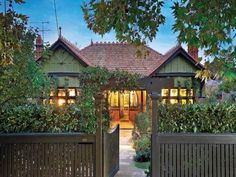 Front yard on pinterest picket fences driveway gate and Tudor style fence
