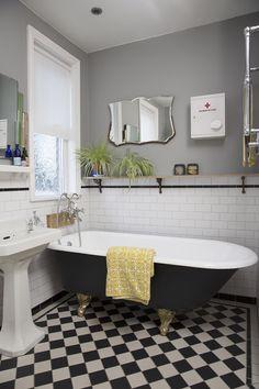 Bathroom - Victorian tiled floor (with underfloor heating) // Original Victorian Cast Iron Bath // 1920's mirror // 1950's first aid boxes // Farrow & Ball - Manor House Gray
