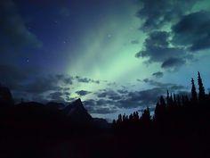 An aurora above Mt. Chephren in the northern section of Banff National Park. Banff National Park, National Parks, Canadian Rockies, Aurora, Serenity, Northern Lights, Beautiful Places, Coast, Journey