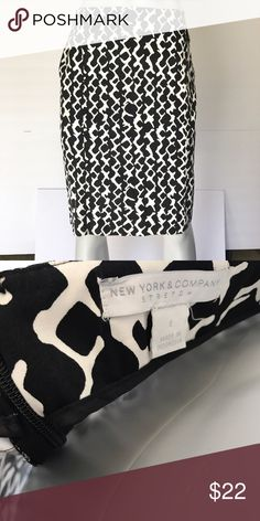 {new york & company} black & white patterned skirt Gorgeous knee length skirt is black with white pattern. Zips up in back. Business skirt with some stretch. Pretty for professional work settings! New York & Company Skirts Pencil