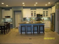 Our Finished Kitchen.  White cabinets with blue sea glass tile backsplash