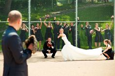 this has got to be the cutest wedding photo of all time for a couple who love/play baseball! Husband as the pitcher, beast man as the catcher, bride as hitter, and bridesmaid holding the dress
