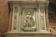 San Rocco all'Augusteo, Rome. Detail of the pulpit, marble relief sculpture of St. Rocco.