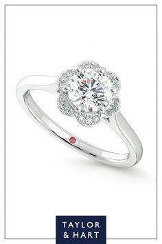 Take inspiration from our wonderfully classic diamond halo engagement ring.The Fleur combines a round diamond centre with a floral-inspired diamond halo set in platinum. Get in touch and let's craft your dream ring! #engagement #engagementring #Halo #diamond #platinum