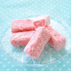 Pink lamingtons with strawberry icing. Nice for a sweet table.