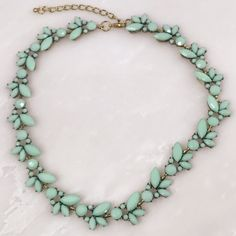 Mint Ivy Necklace Mint Ivy Necklace  18k Gold plated Mint Ivy Necklace. Glass detailing ivy set stones in 18k gold setting. Stunning necklace with mind floral stone design detail. T&J Designs Jewelry Necklaces