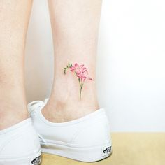 22 Beautiful and Delicate Freesia Tattoo Designs – foot tattoos for women flowers Pink Flower Tattoos, Flower Tattoo Foot, Flower Tattoo Shoulder, Floral Tattoos, Flower Ankle Tattoos, Tribal Tattoos, Foot Tattoos Girls, Ankle Tattoos For Women, Small Tattoos