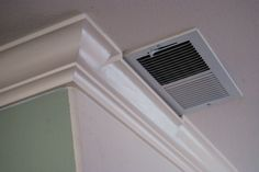 When a vent is too close to the corner you must improvise!   For more example of our work, please visit our website! www.tflarkin.com. Crown Molding Installation, Wall Trim, Modern Farmhouse, Wood Crafts, Home Appliances, Diy Projects, Air Vent, Moulding, Basement