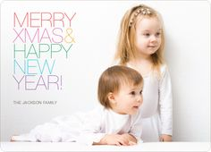Merry Xmas + Happy New Year Photo Cards - Multi. Simple, bold and colorful. This Christmas and New Years photo card let's your photo be the star with its simple, yet distinctly modern design. For this card to work best, we recommend a picture against a solid, light colored background. A simple shot against a wall works great. Printed on premium 100% recycled paper.. Price: $2.59