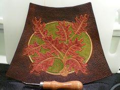 Hand tooled leather oak leaf arm bracers
