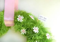 This adorable Spring wreath is easy to make and is the perfect way to welcome in Spring. Easy Spring Wreath DIY on A Helicopter Mom